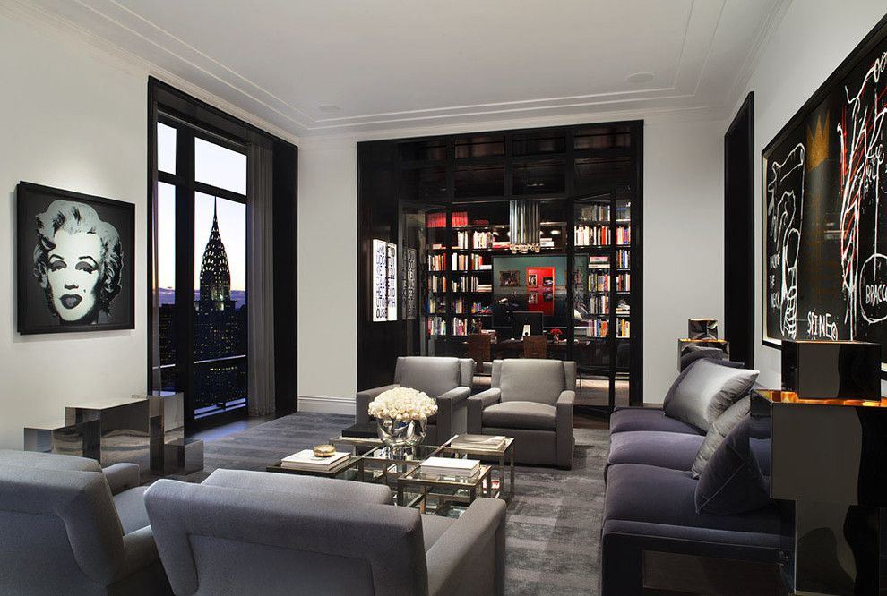 Robert Granoff - Here, black trim adds weight to an all-white room. It creates a modern look and goes well with clean lines and simple casings.