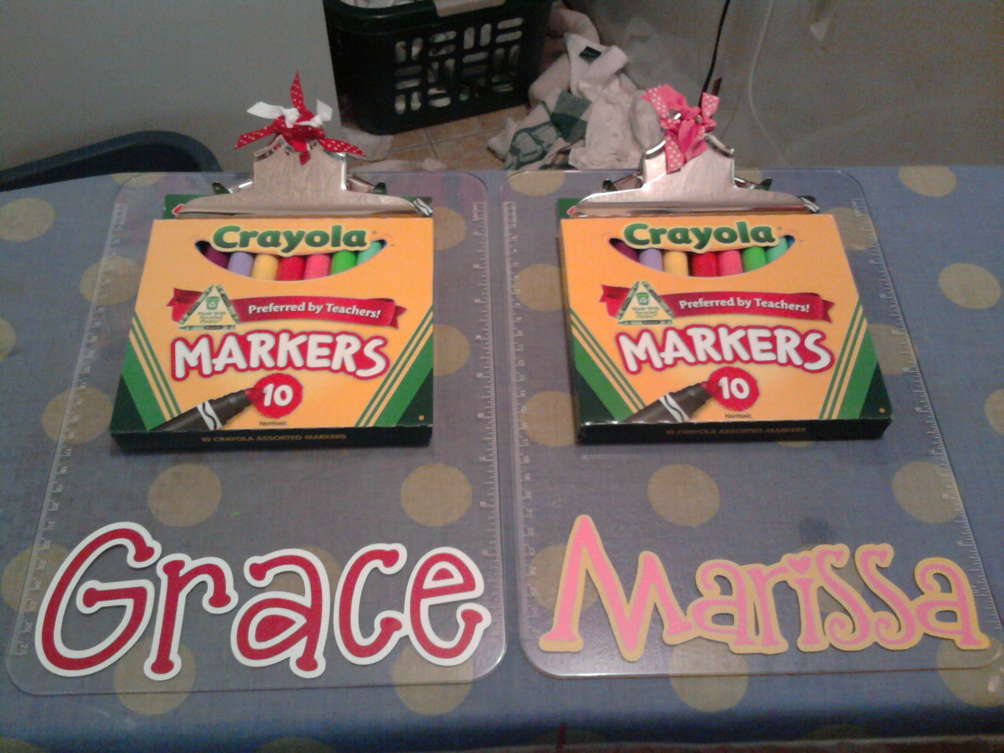 I try to come up with an inexpensive go-to birthday gift every year for friend parties.  This year I bought clipboards from Wal-Mart & personalized them & put a pack of markers with them (stocked up on 97 cent markers during back-to-school). Jolie was proud to give them :)