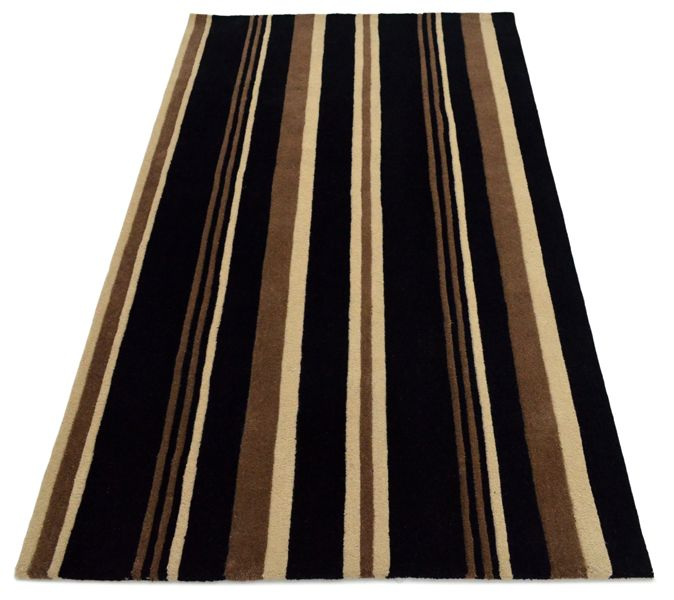 A Fully Bespoke rug hand tufted with wool in black, brown and beige. It has a pile depth of 12-14mm. Created using the customers own design.