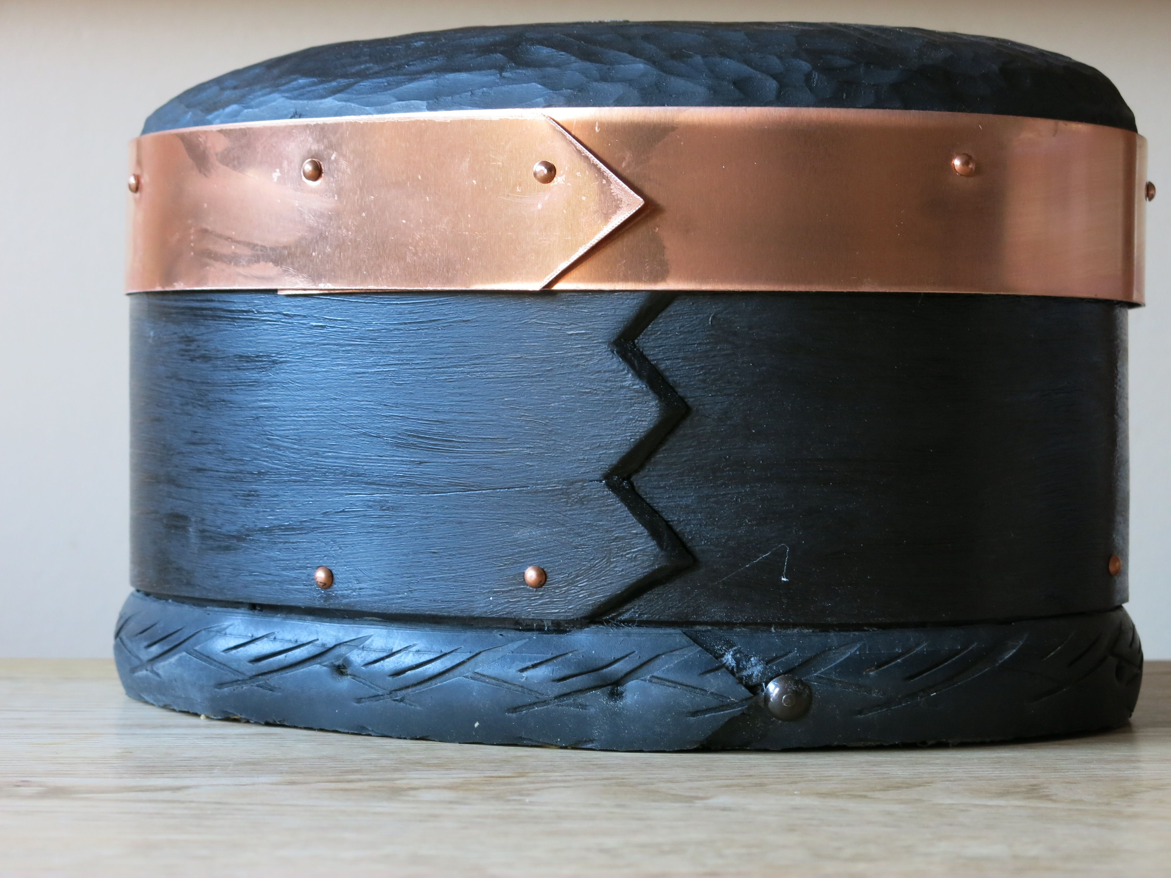 Steambent wooden box with copper and bicycle tire.