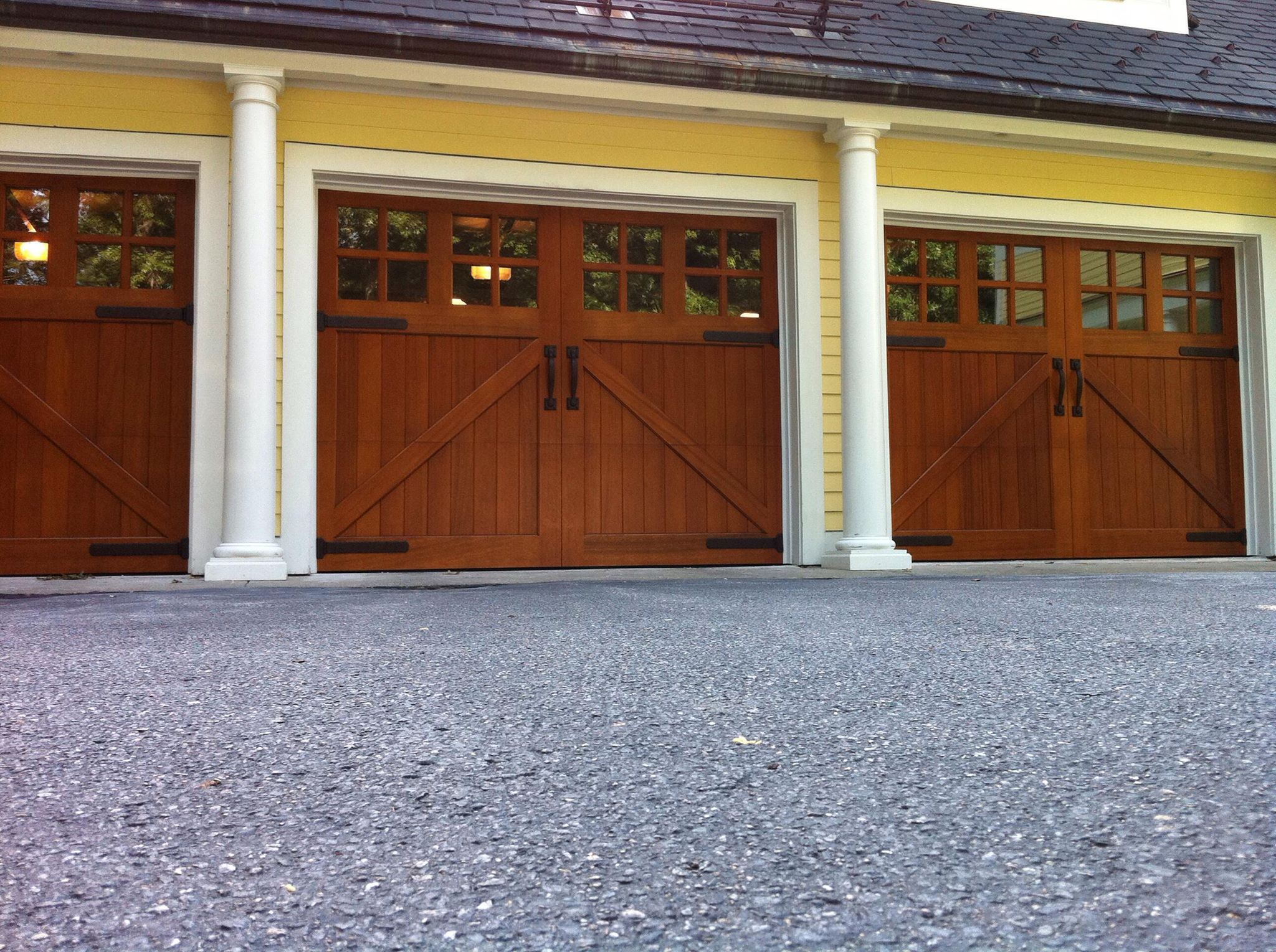 Clopay reserve collection custom wood carriage house for Clopay wood garage doors