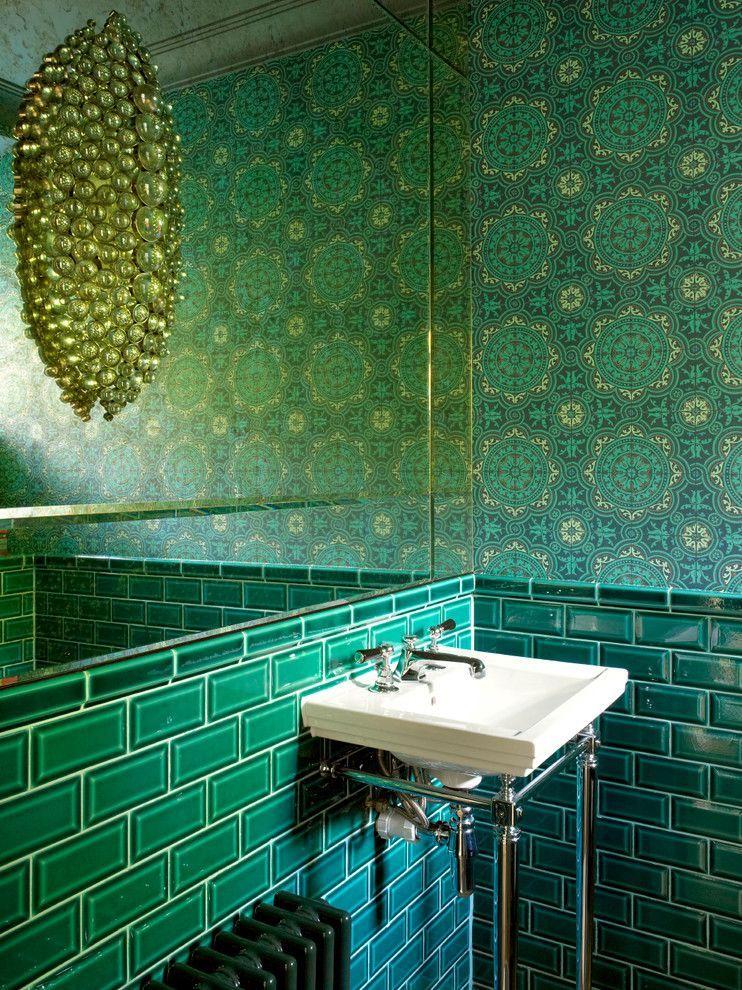 An unusual lamp in a green bathroom resembles a precious decoration ...