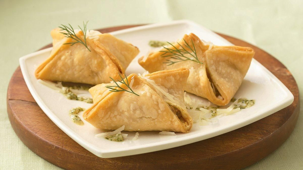 Salmon Pastries with Dill Pesto recipe and reviews - Each little appetizer bundle is bursting with salmon and cheesy-dill flavors.