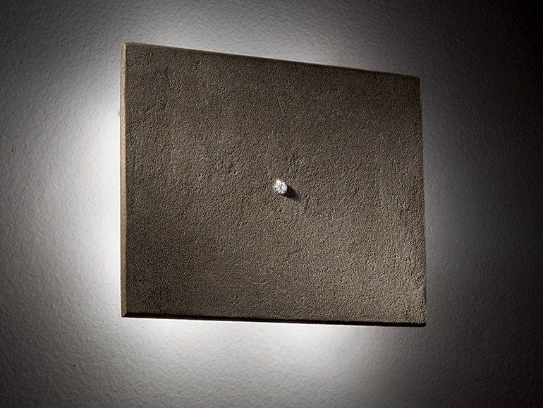 Ganz einfache Betonfliesen mit einem Swarovski-Kristall machen sich auch super als Lampenschirme für indirekte Beleuchtung
