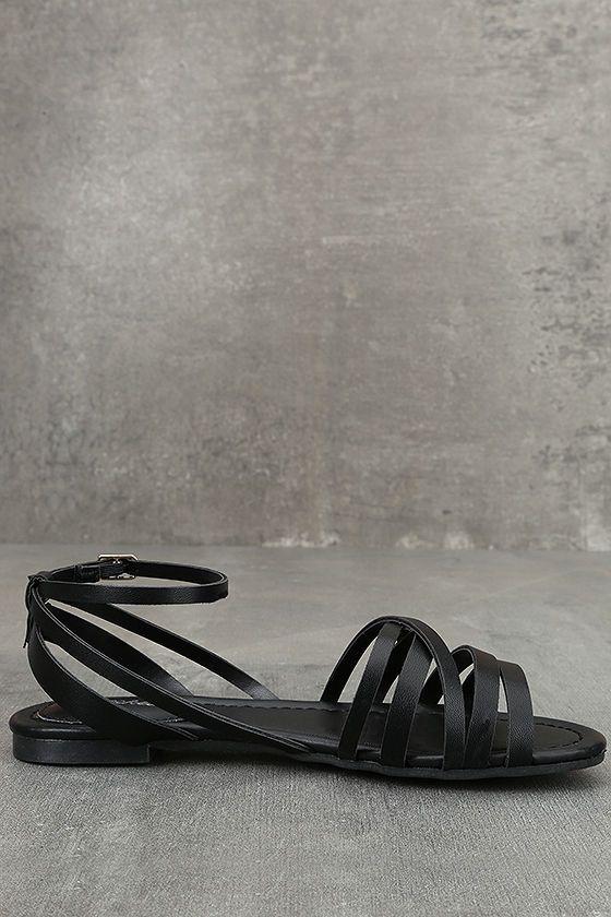 Your first steps in the Zoila Black Ankle Flat Sandals should be straight toward the sun and sand! Vegan leather straps cross over a peep-toe upper, while a matching ankle strap (with adjustable gold buckle) completes the look.