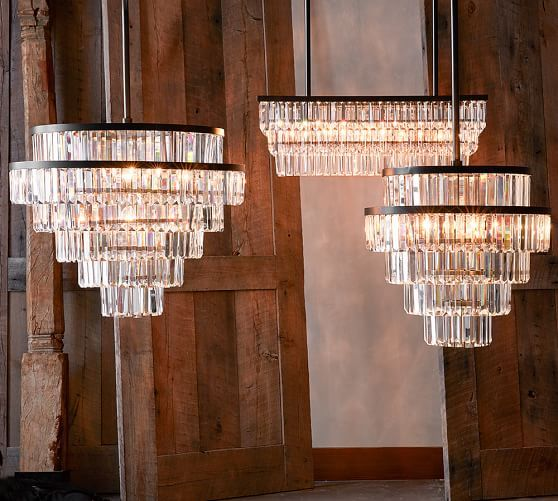 They hang from smooth bronze finished bands in our gemma helix chandelier place it over a dining table