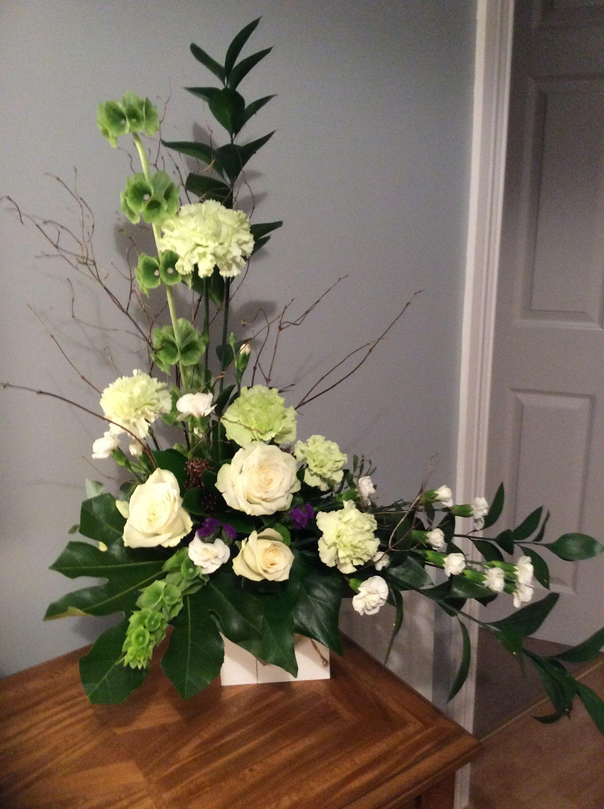 Asymmetrical With Carnations And Roses Church Flower Arrangements Modern Flower Arrangements Floral Arrangements