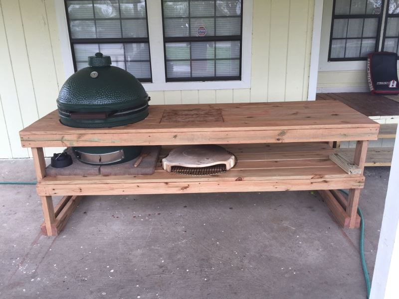 A Xl Green Egg Also 32 Inch X 8 Feet Table Made Out Of Treated Wood With Built In And Removable Cutting Board It Is Storage Right Now
