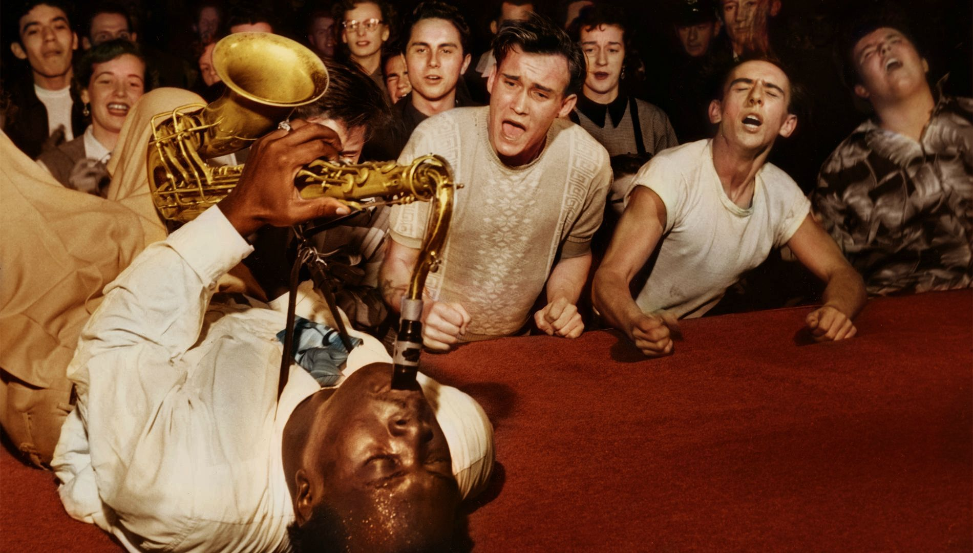 """Colorized photo of Cecil """"Big Jay"""" McNeely (prob. somewhere in LA, early 1950s) - The Godfather Of The Rock & Roll Saxophone, King Of The Honking Saxophone, The Go! Go! Go! Man, """"a jazz musician who was playing for people who wanted to dance"""". Read this:  http://www.jazzwax.com/2009/07/interview-big-jay-mcneely-part-1.html"""
