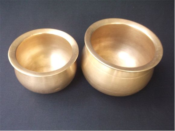 The Antique Brass And Bronze Pots Shown Here Are