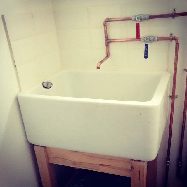 Perfect Utility Belfast Sink With Copper Pipes.