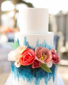 Tiered confection by Hey There, Cupcake! that features lemon cake and blueberry curd filling on the inside and hand-painted frosting and paper bloom garnishes on the outside. Martha Stewart Weddings