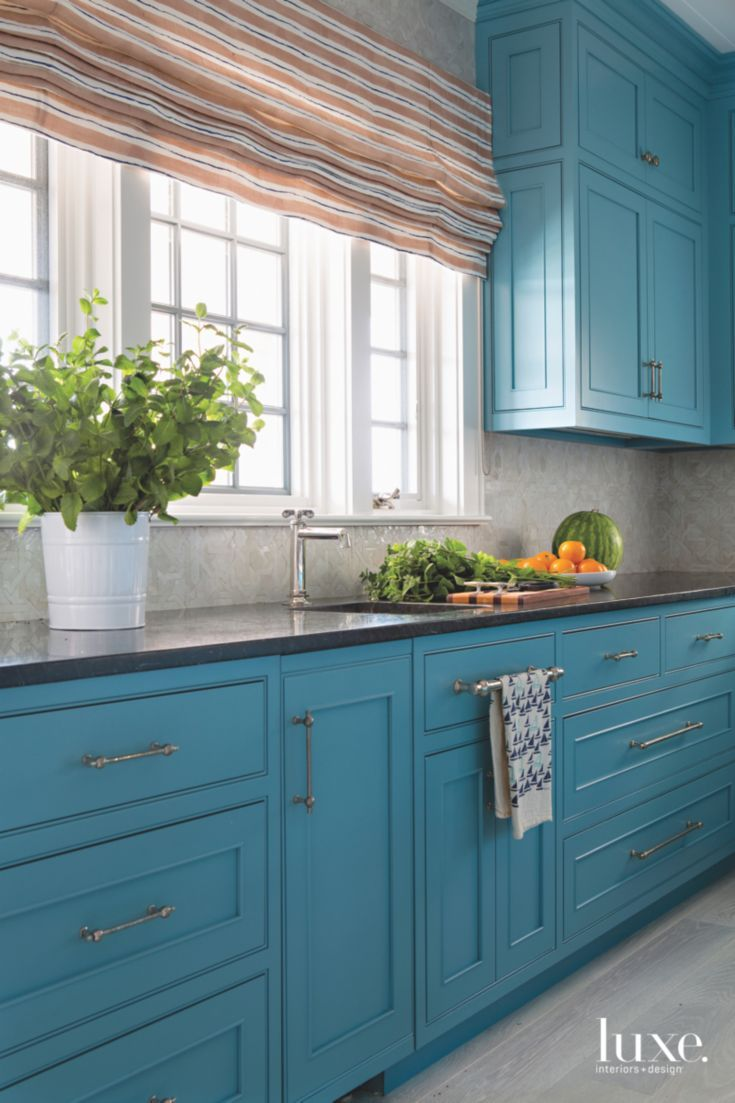 Strong Blue Cabinet Kitchen with Striped Warm Colored Roman Shades ...