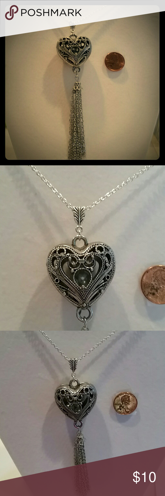 """Stirling silver chain holds heart tassel pendant Strikingly Beautiful handcrafted genuine 19"""" striling chain, inside of heart locket R real pearls! ! ! ! Handcrafted by me with a ton of Love! ? ?? ? ?? ? ?? ? ?? ? ?? Always made of high quality beads and materials! Custom 1 of a kind designs!  #greatdeal  #hotlook  #UwilllookMarv  #Classylook  #Sassy  #uniqueisgreat! ! ! ! ! ! ! !  #Onlyuwillhave! ! ! ! ! ! ! ! ! ! ! ! ! my own  Jewelry Necklaces"""