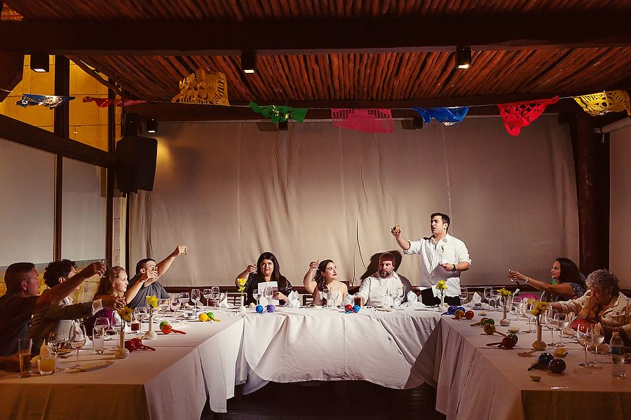 Intimate wedding reception with colorful papel picado at Azul Beach ...