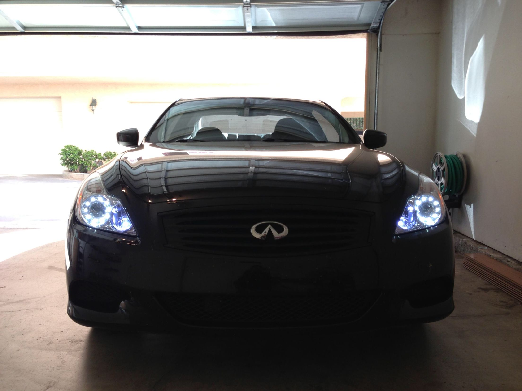 Black coupe w/ Angel Eyes and Iron Man headlights | G37 | Car, Angel