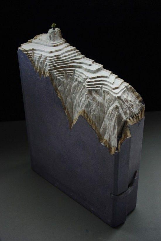 carved book guy laramee 1 550x821 Paysages sculptes dans des livres