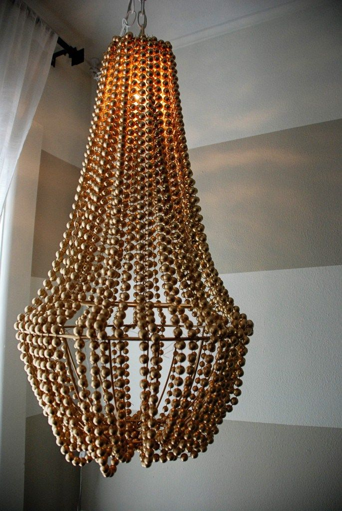Upcycle a plain chandelier into a beaded showpiece beaded diy wood bead chandelier and 16 beaded chandelier tutorials but use capiz shells instead of mozeypictures Images