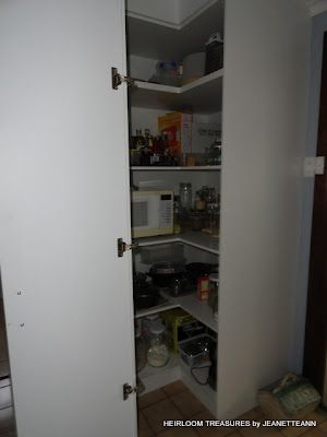 laundry room corner cupboard used for pantry,fold back ...