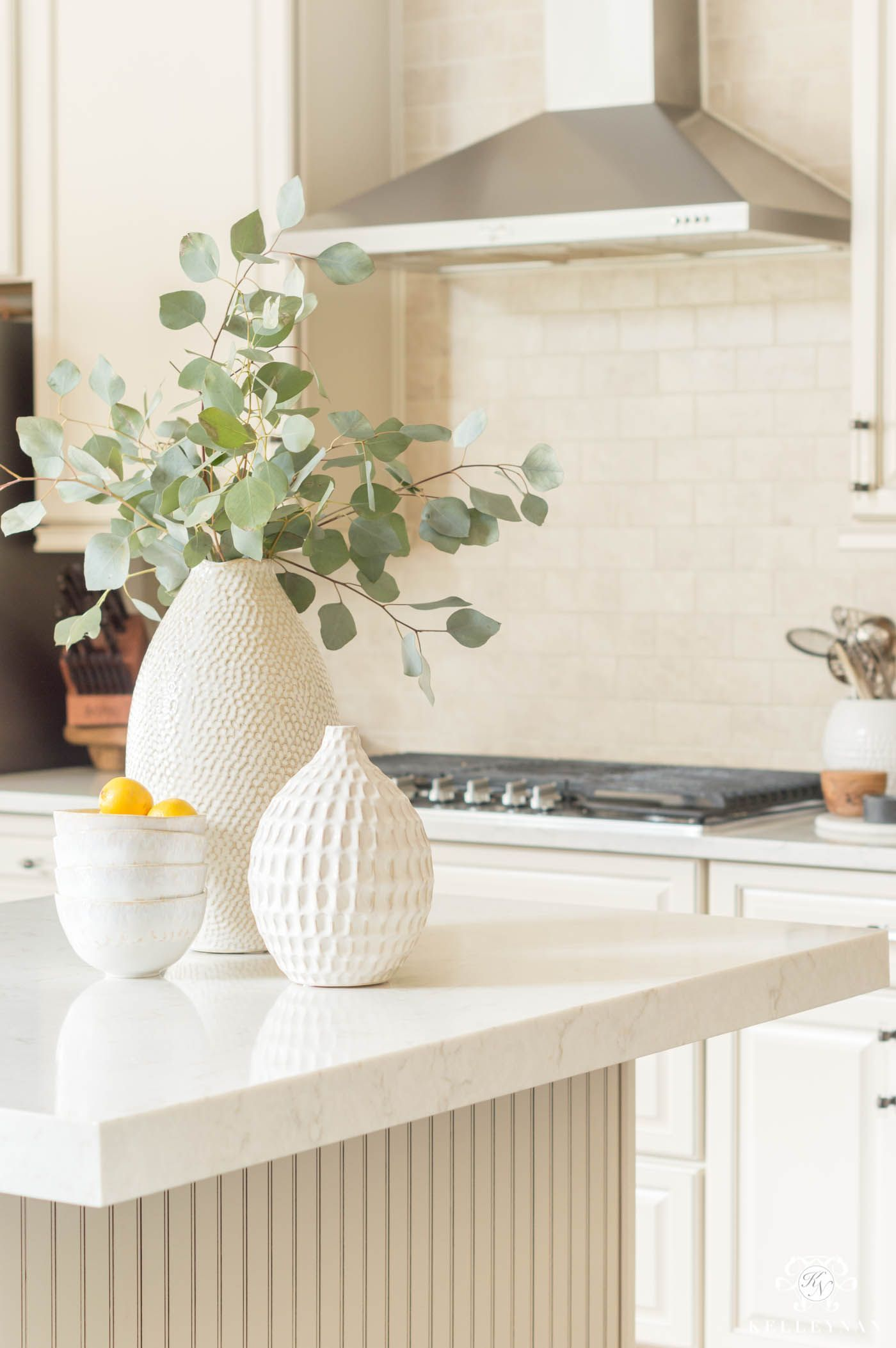 Kitchen island decor and clusters of vases. #floral #kitchendecor