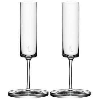 Karl Lagerfeld Champagne Flute Set. In Karl Lagerfeld's hands, the traditional sloping champagne flute is reimagined with straight sides and clean, strong lines that float above a graceful stem. $300.00