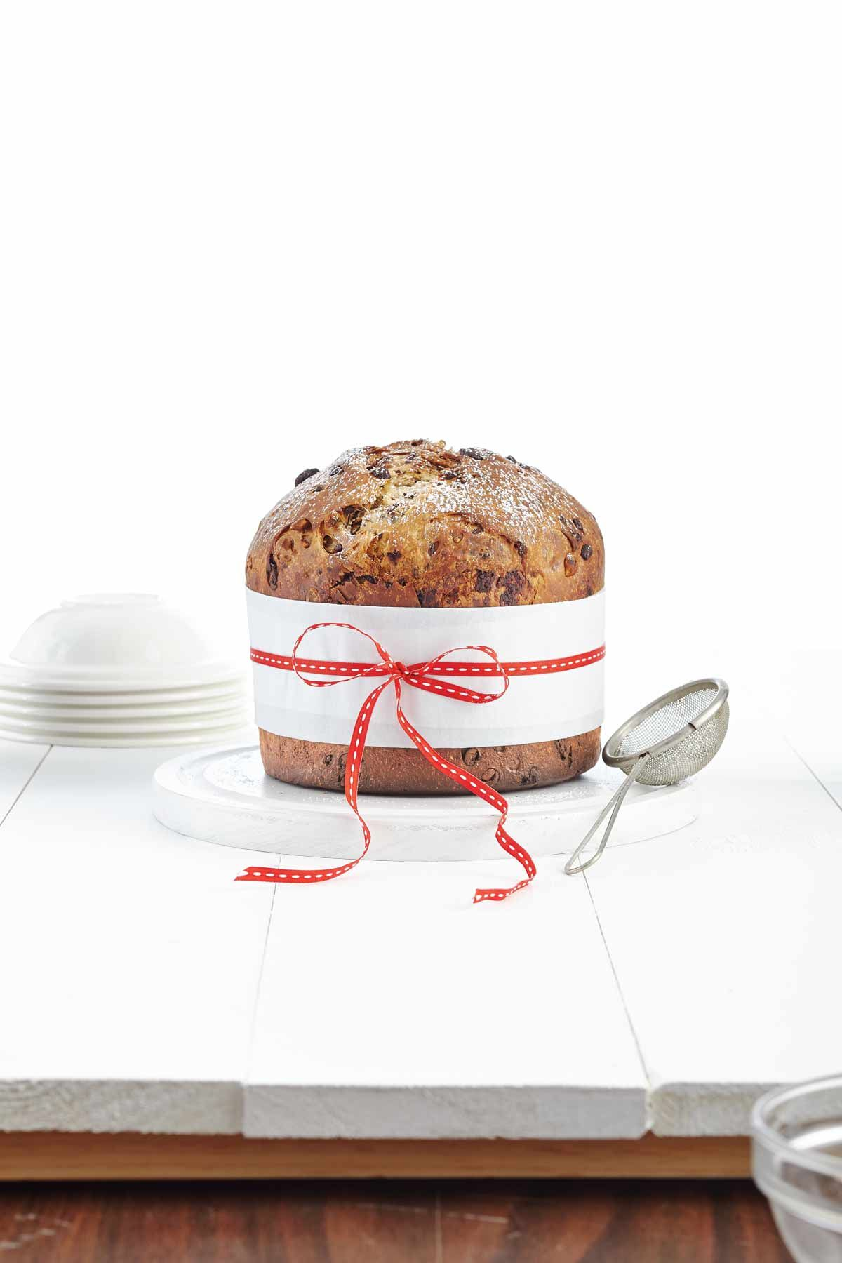 Panettone, a tall and cylindrical sweet bread made from a buttery, egg-rich dough, is an Italian Christmas classic. While it's traditionally made with dried fruit, we've added indulgent chocolate and roasted hazelnuts for the most decadent dessert possibl