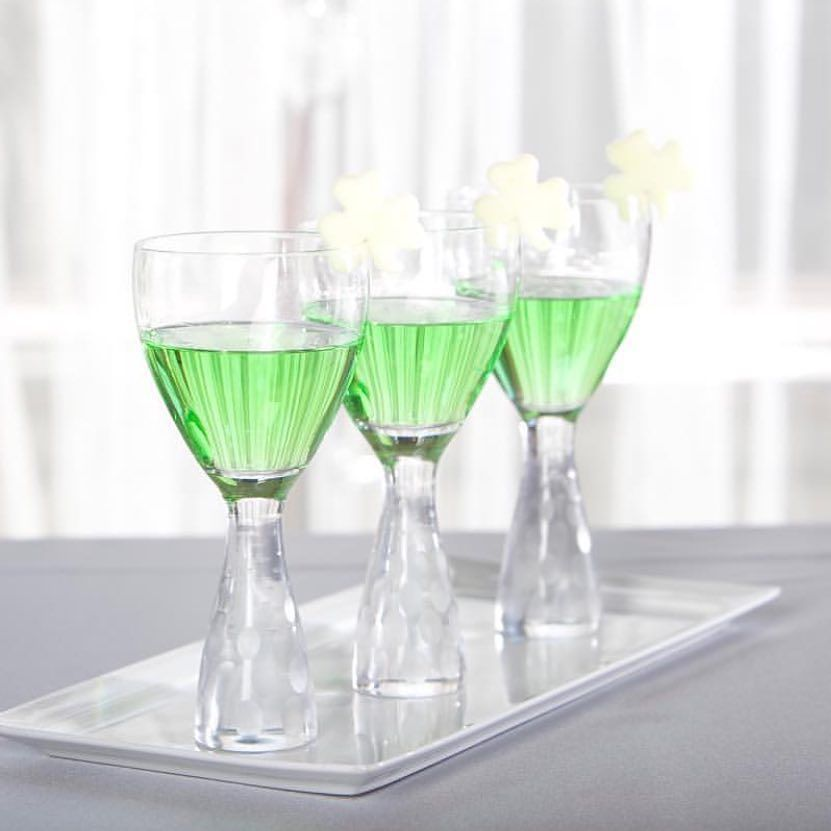 Cheers to you this St. Patrick's Day!  Try a poacheen for your signature cocktail made from Apple Pucker Vodka and an Apple Shamrock Garnish  Photography: @georgestreetphoto; Venue: @germaniaplace; Caterer: @kenmarecatering; @ktofoodcarnival