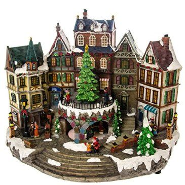 led village with animated tree httpshopcrackerbarrelcomled - Animated Christmas Village