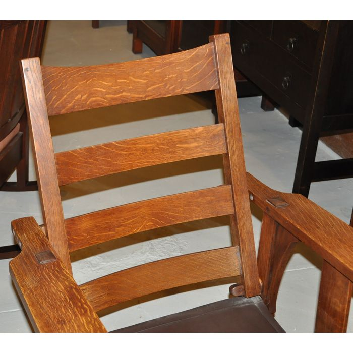"Description: Early Gustav Stickley Morris chair, #2341, flat-arm form with two vertical slats and corbels at sides, recovered seat and back cushion, replaced sling seat, cleaned original finish, unsigned, 30""w x 34""d x 36.5""h, very good condition"