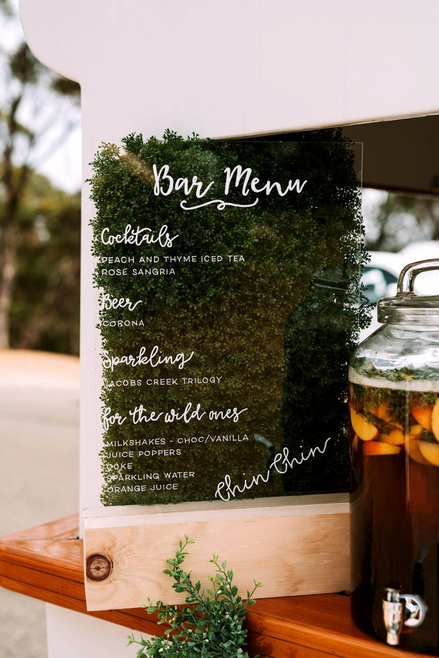 Looking for a smaller, subtler way to adapt this trend into your own bar décor? A living bar menu (like this one by Signed By Bird, Cloud 9 Event Management, and The Faux Flower Company), constructed exactly the way so many of these life-sized structures are, is your best option.