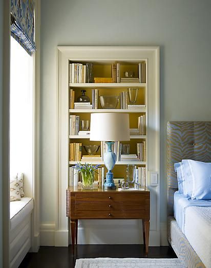 All The Necessary Components For A Fabulous Bedroom Warm Blue Palette Built In Bookshelves Gorgeous Lighting And Window Seat Perfection