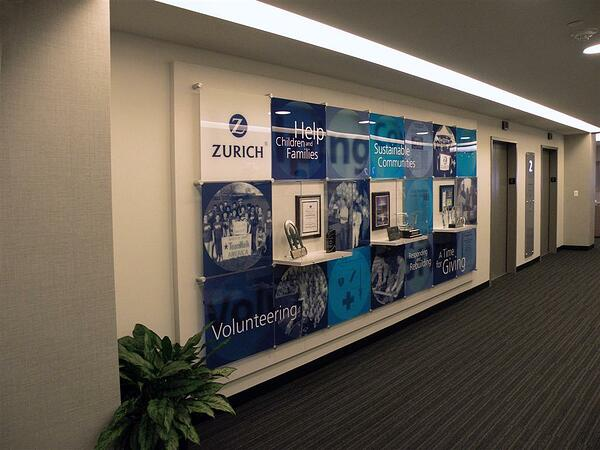 Examples of corporate achievement walls using graphics and