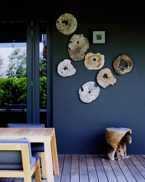 Patio Space With Wood Slab Slices Hung On A Blue Wall.