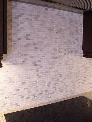 Kitchen backsplash in Bianco Carrara mini brick