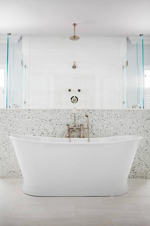 A Freestanding Bathtub And A Gooseneck Floor Mount Tub Filler