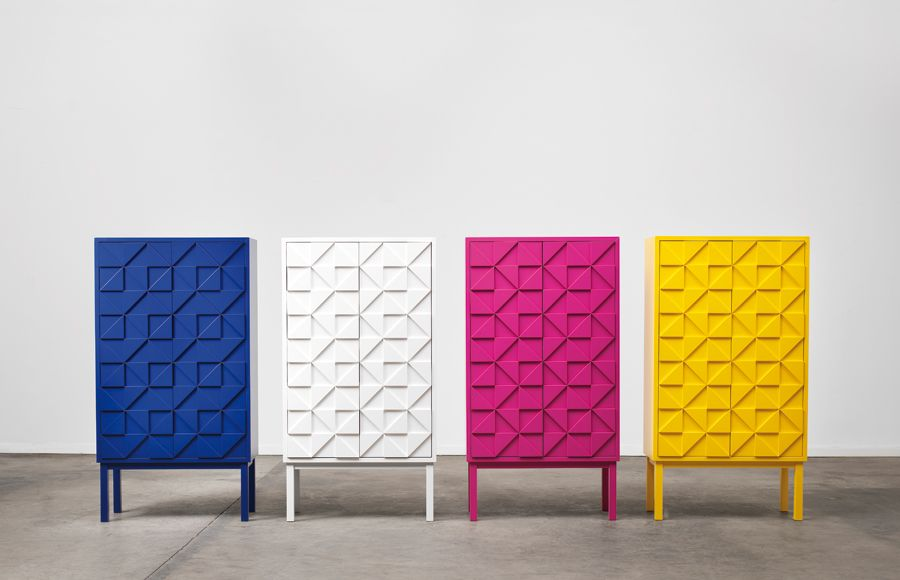 love these colorful storage cabinets ... the triangle pattern and the basic block shape makes me think lego