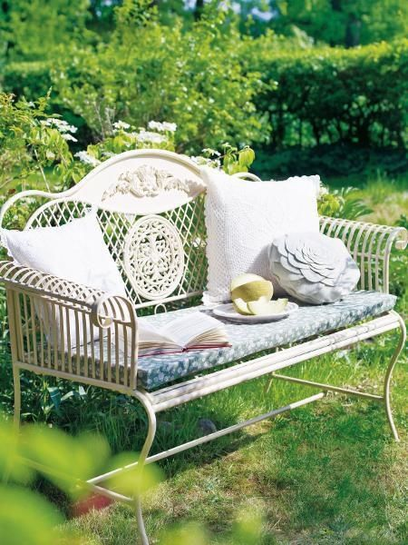 Adorable Wrought Iron White Bench With Scrolls And Cute Cushion In