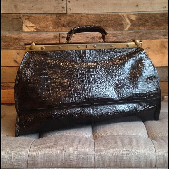 """Italian Lordun Black Handbag, Medicine Bag Style Excellent condition, rare vintage Italian Lordun black patent leather handbag.  High fashion style with metal hardware and arm hinges inside when opening.  Measures 22"""" long x 13.5"""" tall x 6"""" deep.  Good size for an overnight trip. Lordun Bags Satchels"""