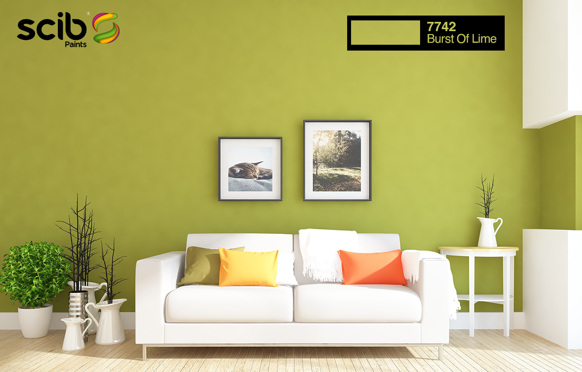 A Modern Living Room With A White Interior Of Couch And Side Tables Complimented With A Burst Of Lime 77 Yellow Painted Walls Interior Wall Paint House Colors