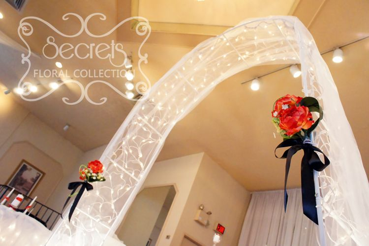 Wedding arch is decorated with white tulle twinkle lights and wedding arch is decorated with white tulle twinkle lights and red peonies bouquets junglespirit Choice Image