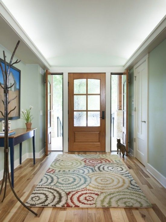 Paint color goes well with white and oak trim. office foyer design ...