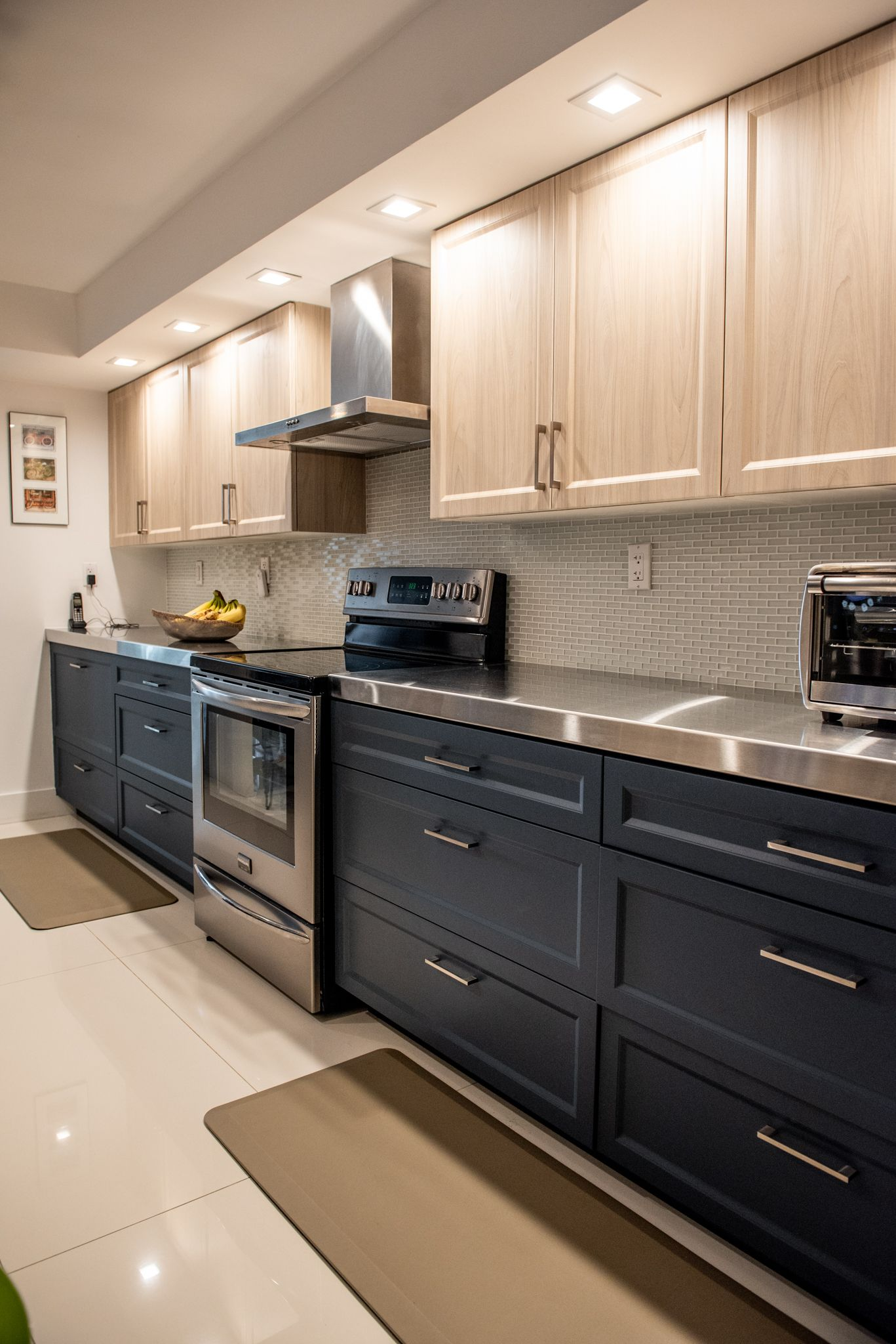Contemporary Kitchen Remodel Done With Cabinet Refacing In A Two Tone Color In 2020 Contemporary Kitchen Remodel Contemporary Kitchen Kitchen Remodel