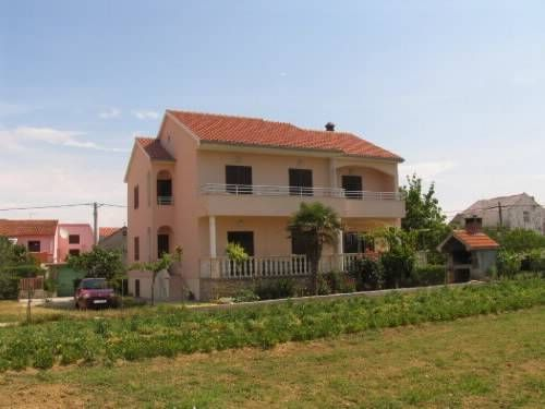 Apartments Nikola Privlaka Apartments Nikola offers accommodation in Privlaka, 19 km from Zadar and 38 km from Novalja. Apartments Nikola boasts views of the garden and is 45 km from Biograd na Moru. Free private parking is available on site.  A TV is provided.