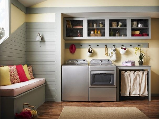 Laundry Room With Top Load Washer Folding Table On The Side Pegs
