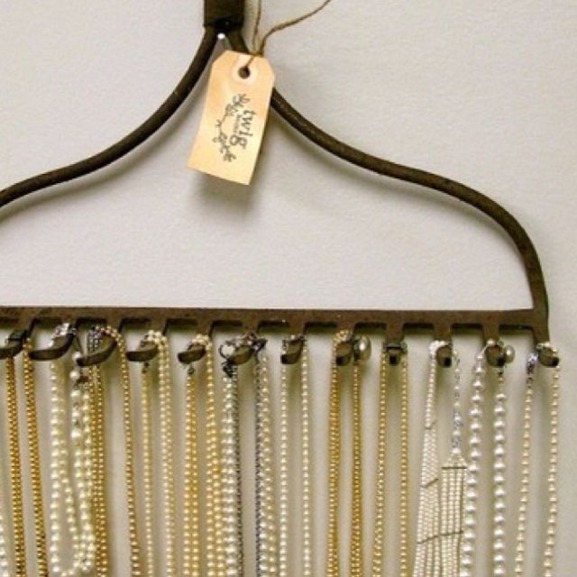 A rake its the perfect inventive way to display long necklaces