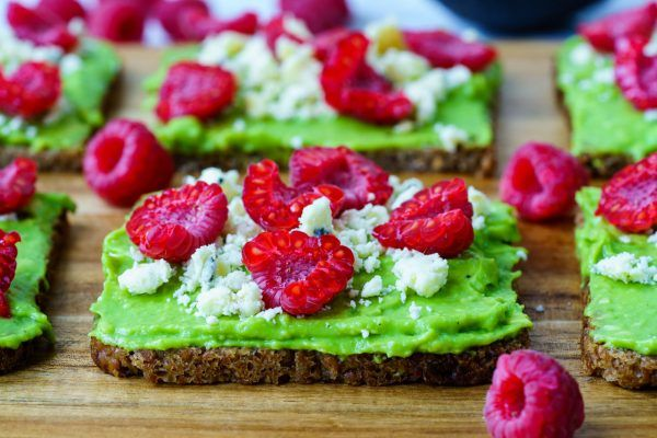 Simple morning meal OR anytime snack idea! The colors are so bright and beautiful, this simple recipe is SURE to make Clean Eating fun :) Ingredients: Makes 4 servings 4 slices of Ezekiel bread, or organic rye bread 1 ripe avocado, mashed ½ cup fresh raspberries 1 oz high quality feta, or blue...