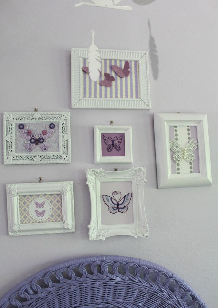Gallery wall featuring butterfly artwork