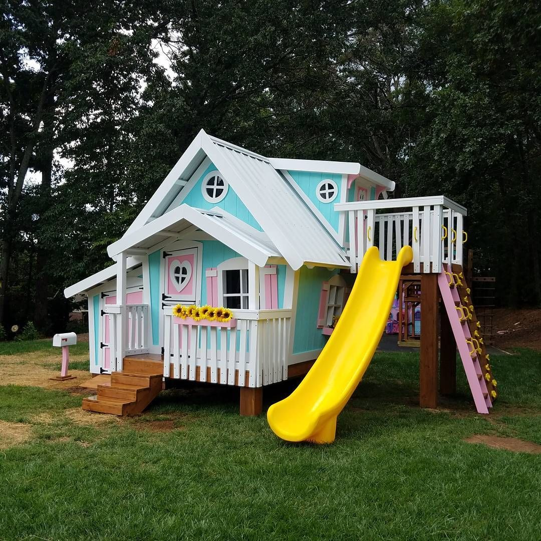 the big playhouse xl with the playhouse dormer slide platform