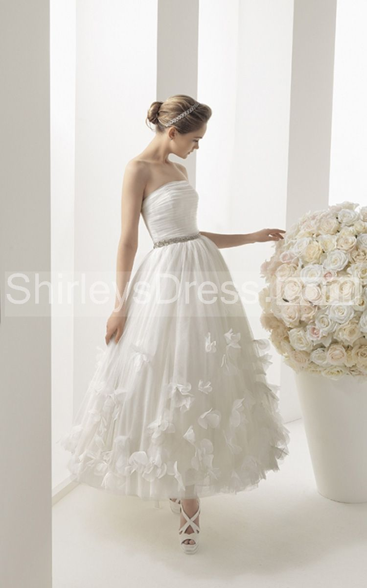 Magnificent strapless ruched bodice tea length dress with petal