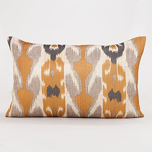 Amber and grey ikat lumber pillow looks great with - Living room curtains with matching pillows ...